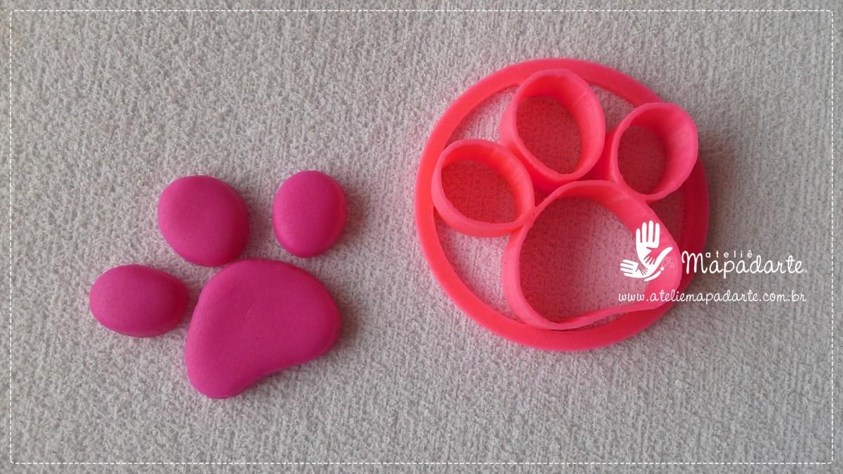 Foto 1 - Cód M1976 Cortador de pata de cachorro 3 dedos em plástico PLA ref.129-8 (AC)