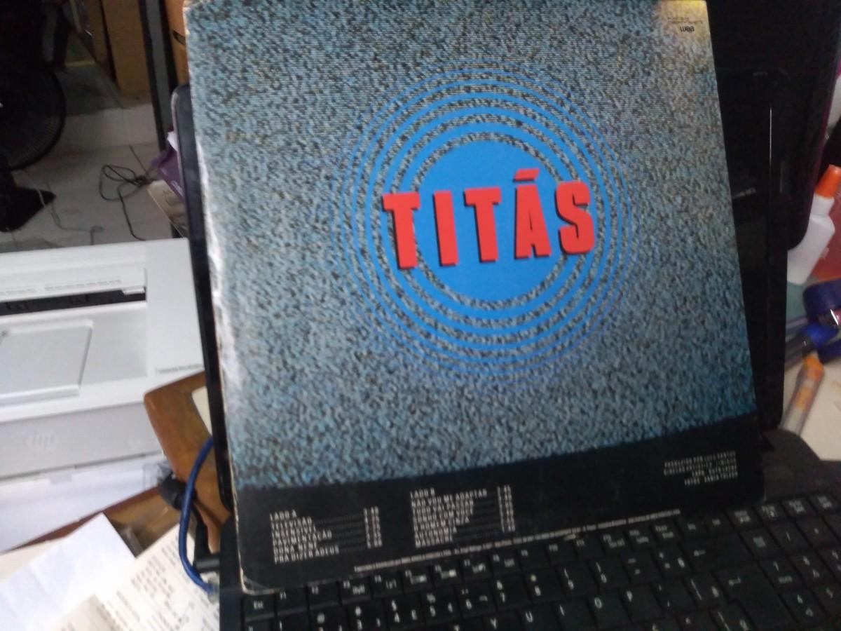 Foto5 - TITÃS, LP Televisão, Warner-1985 reedição 1989 com envelope interno e tudo zero km.